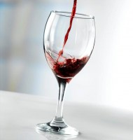 Wine Glass with wine being poured into it