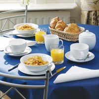 Swansoft Linen Style Paper Tablecovers in a tablesetting