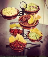 Tapas Stand with 6 terracotta dishes and food